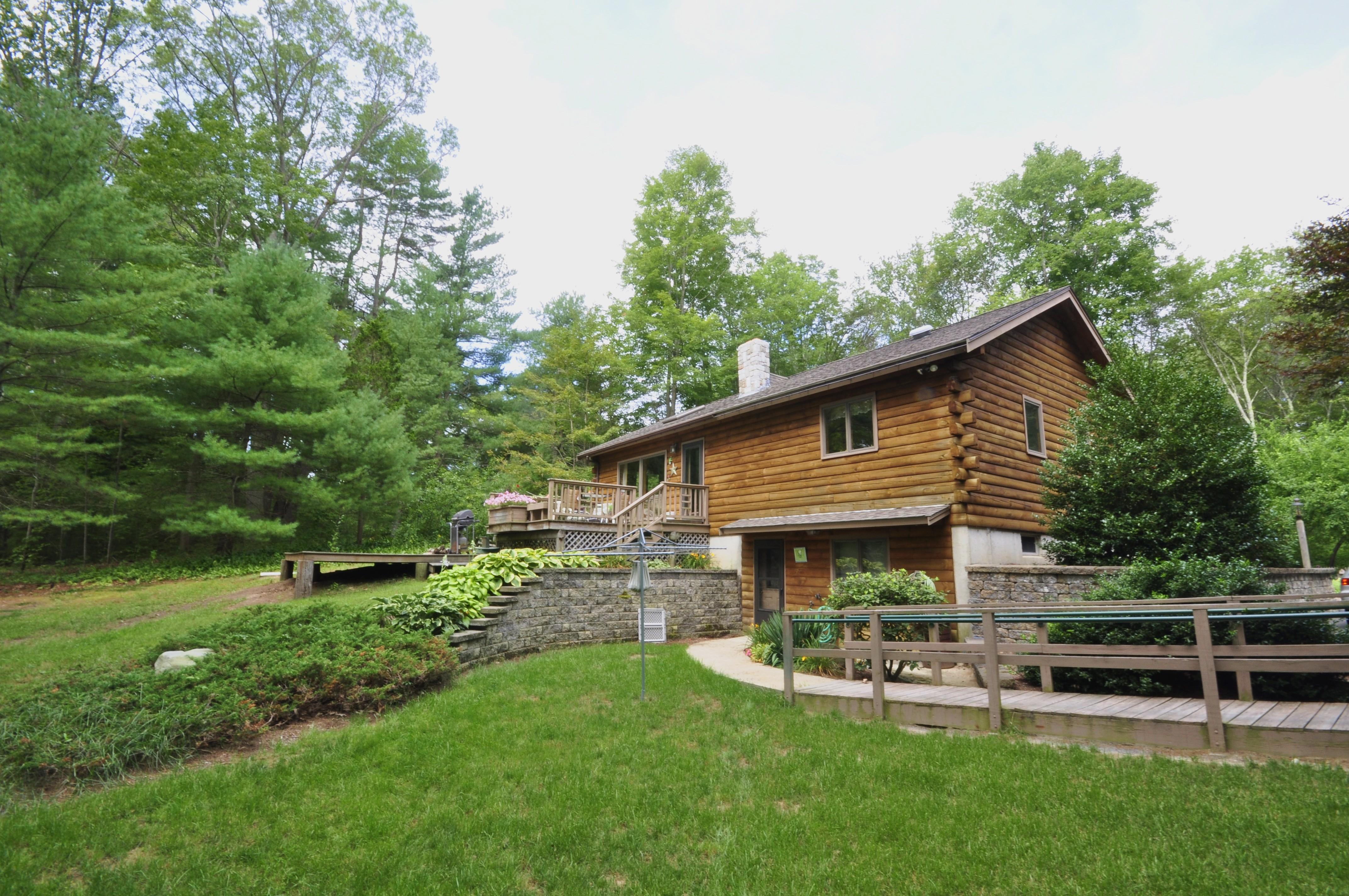 Log cabin retreat lot sold for Log cabin retreat